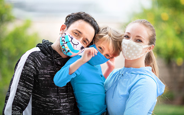 Family wearing face-cover / mask